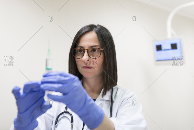 Doctor preparing syringe