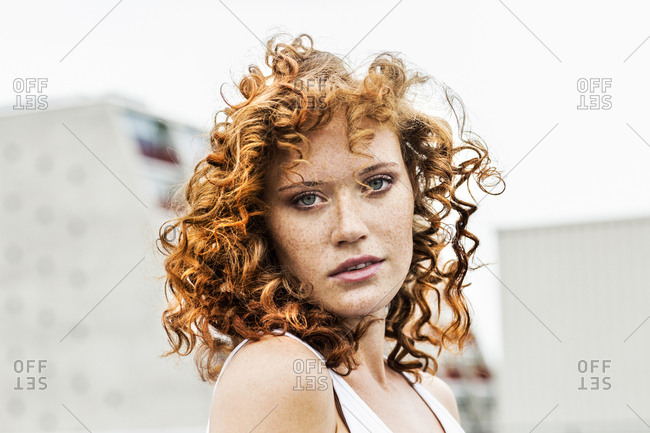 Portrait of redheaded woman outdoors