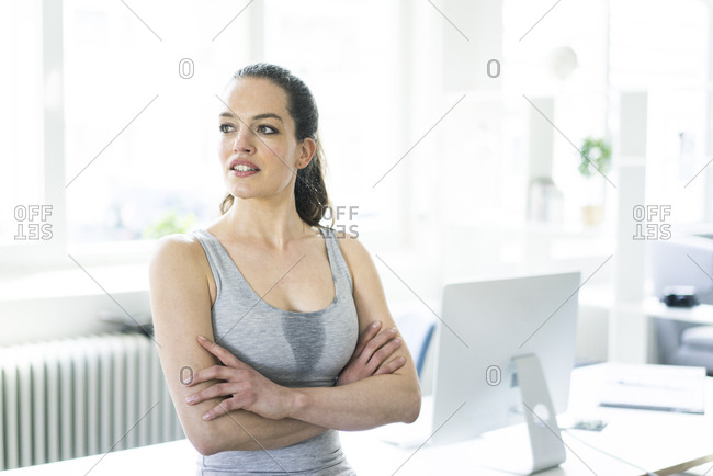 Woman sitting in office after workout