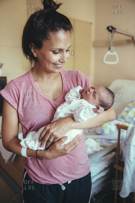 Happy mother holding her newborn baby in hospital