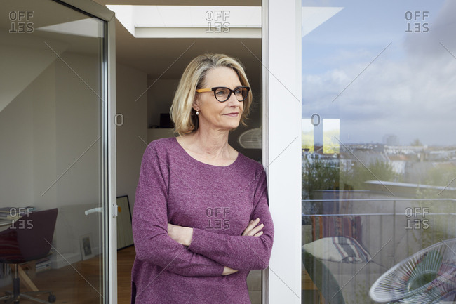 Portrait of confident mature woman on balcony