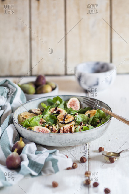 Platter of green salad with figs- Crema di Balsamico- honey hazelnuts and baked goat cheese