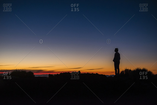 Spain- Tenerife- man on El Teide volcano at twilight
