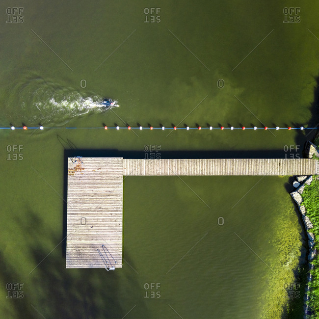 Aerial view of man swimming in a lake
