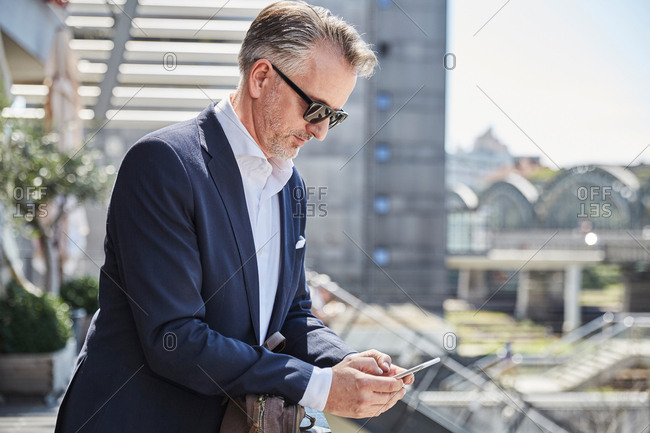 Businessman with sunglasses waiting at the airport