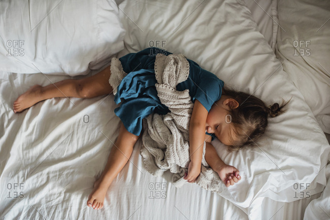 Toddler sleeping on parent's bed