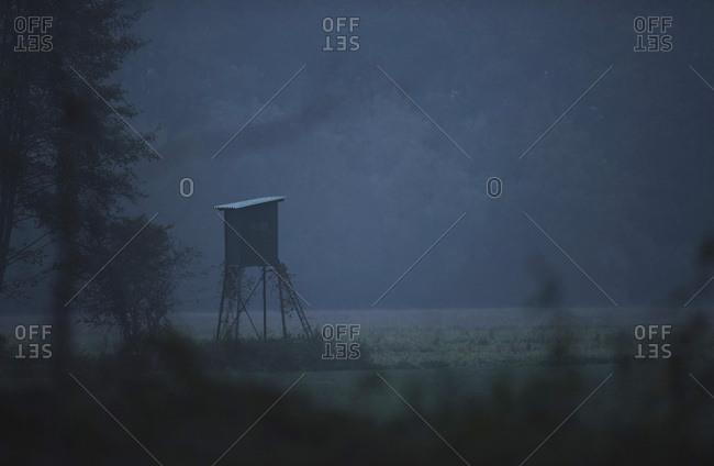 Hunting post in field on misty morning Nordrhein-Westfalen, Germany