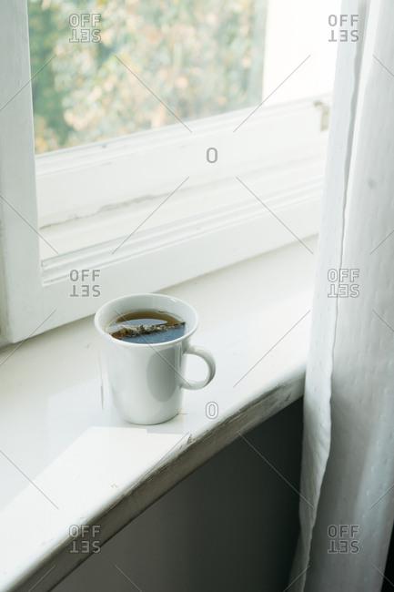 Cup of tea on windowsill