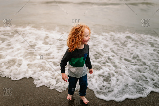 Child at beach on cloudy day