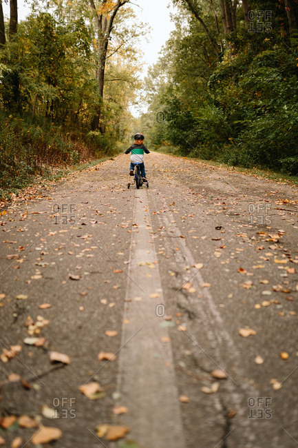 Child riding bike on trail