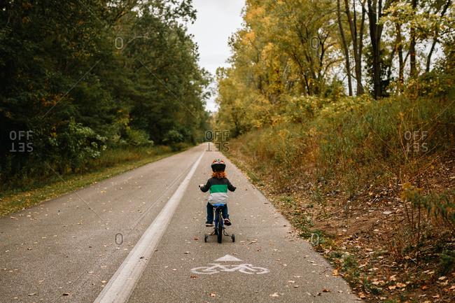 Child riding bike on trail
