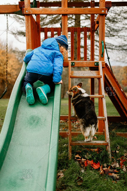 Child and dog playing on playground