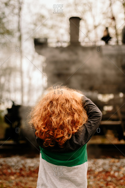 Boy admiring steam train