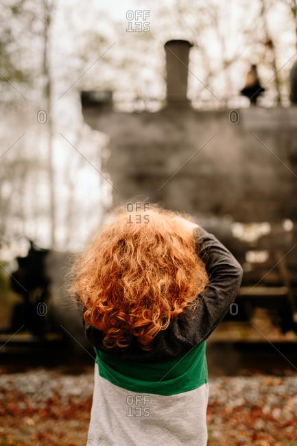 Boy admiring steam train
