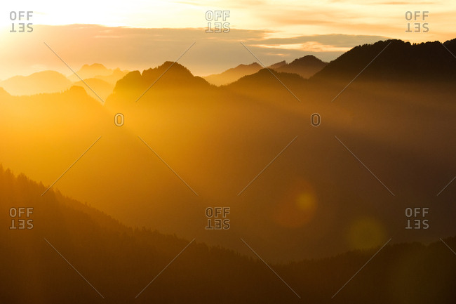 Orange sunset over mountains on Vancouver Island, British Columbia, Canada