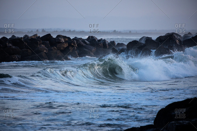 Curling waves by rocky shore