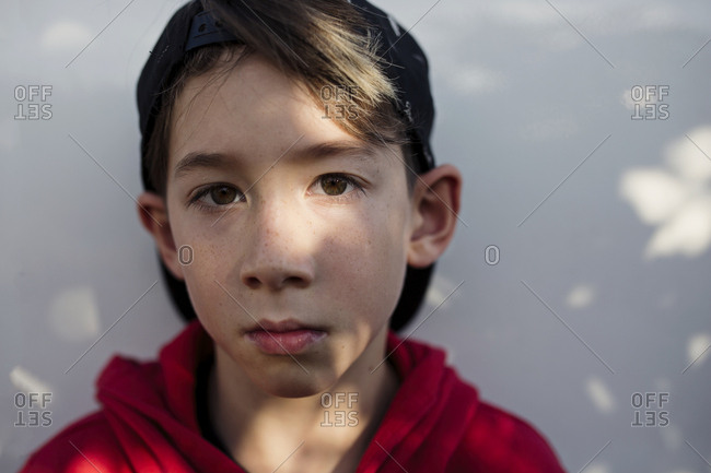 Portrait Of A Boy With Brown Hair And Brown Eyes Wearing A