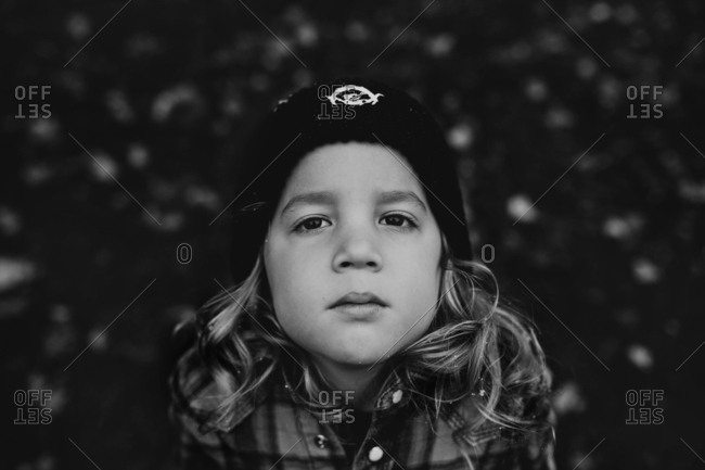 Portrait of a boy wearing a knit hat and flannel shirt