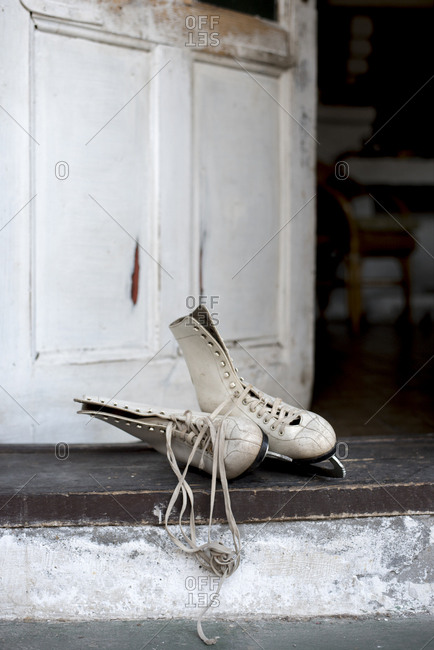 Pair of vintage ice skates left on doorstep.