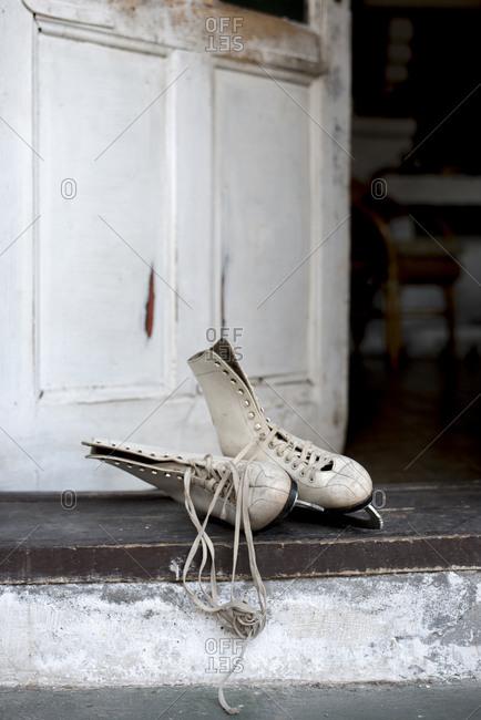 Pair of vintage ice skates left on doorstep.