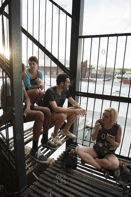 On July 21, 2012 in Brooklyn, New York, crowds of young people gather on a fire escape