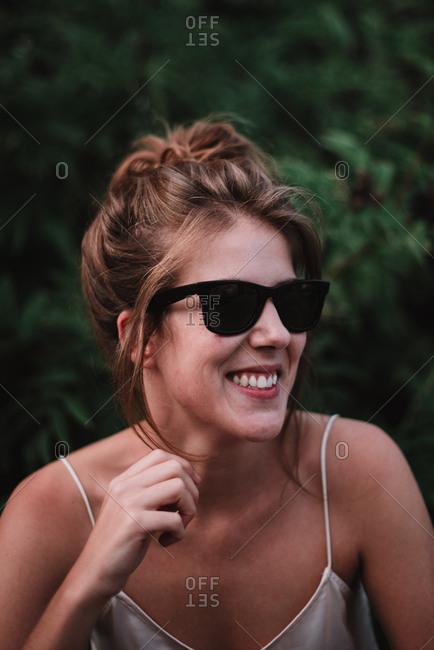 Playful model in sunglasses