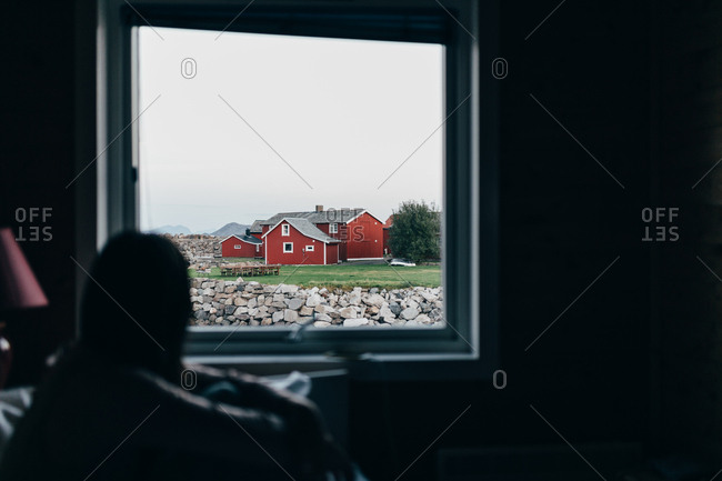 Woman on bed looking out window