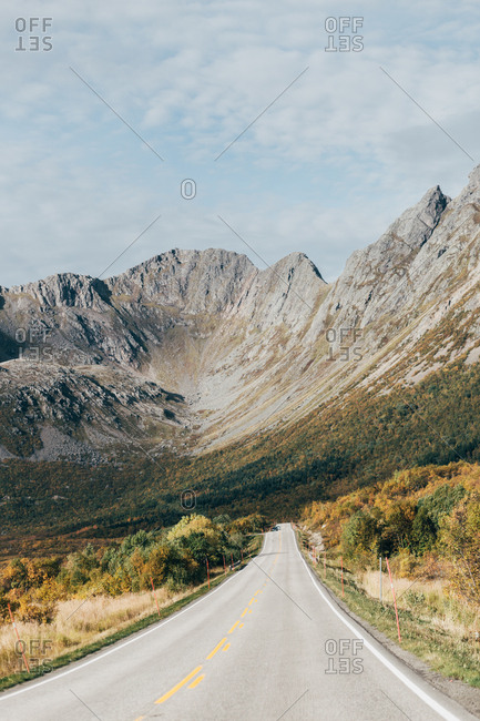Perspective view of asphalt road in picturesque mountains