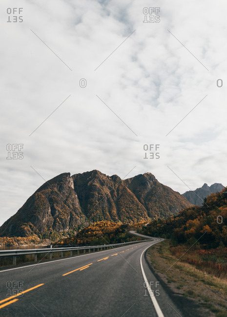 Empty road in mountains - Offset