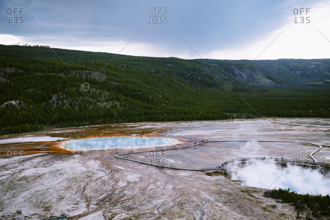 Idyllic view of hot springs by mountains at Yellowstone National Park