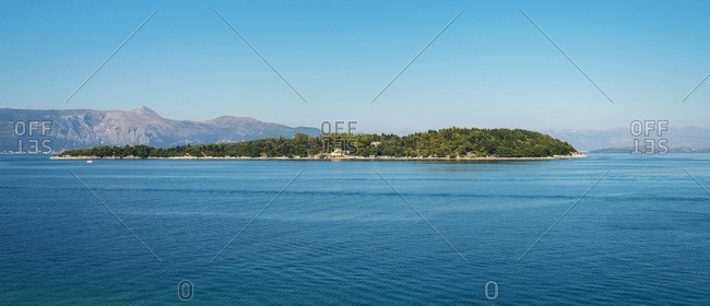 Small green island between Corfu and Albania. Kerkyra city, Greece