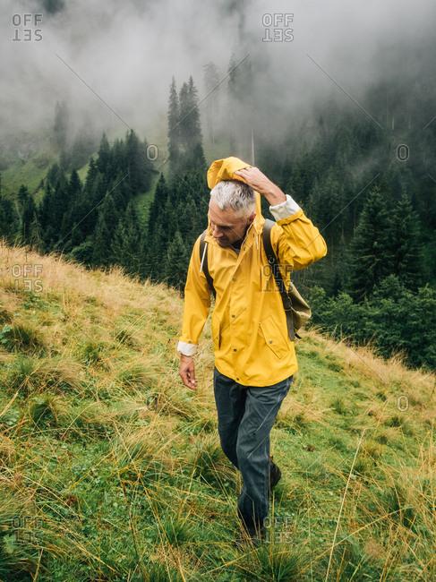 Man hikes up mountainside