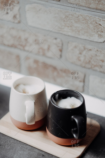 Coffee mugs, with home made coffee and milk foam