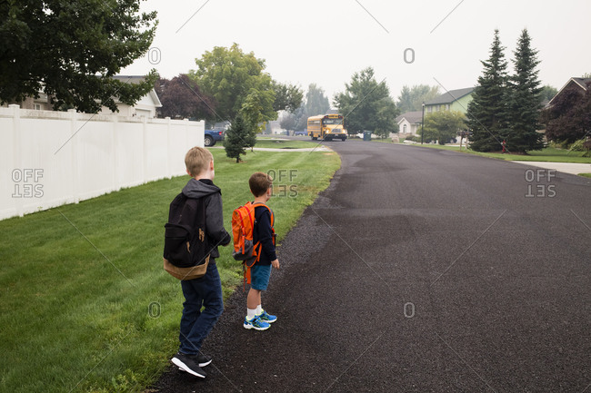 Toy boys await the school bus