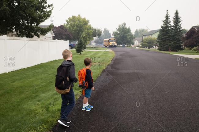Toy boys await the school bus
