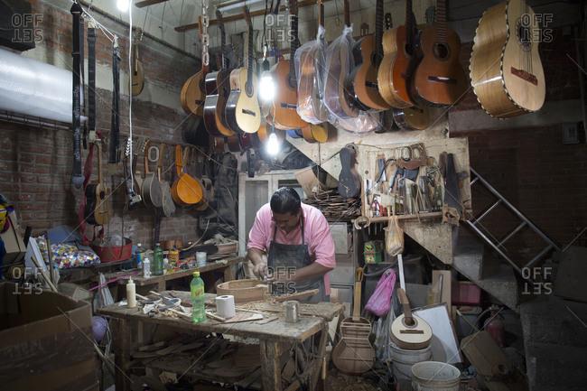 Mexico City, Mexico - November 3, 2017: Mercado de Artesanias La Ciudadela, guitar maker