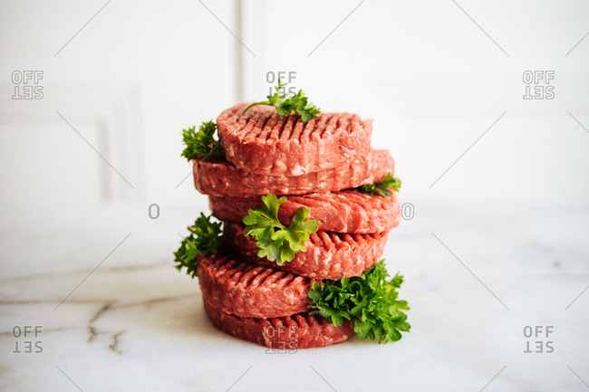 Raw meat patties stacked on top of each other