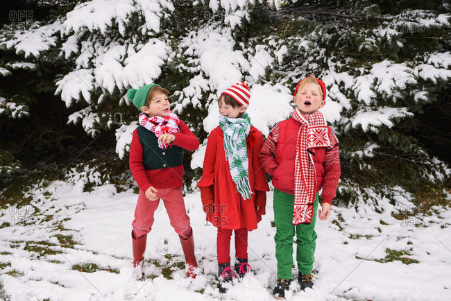 Three young children dressed as Christmas elves