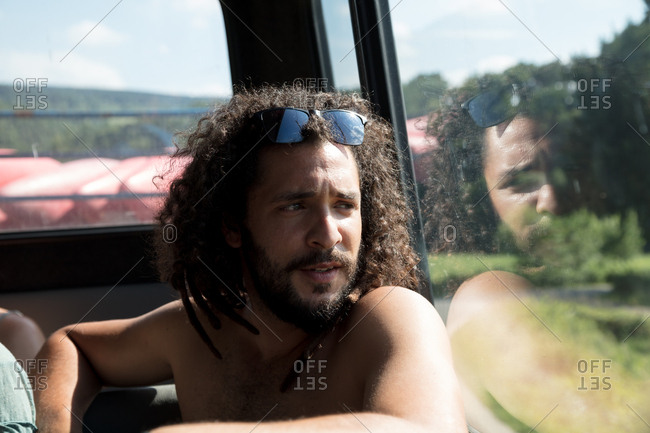 Dreadlocked man on a kayak trip