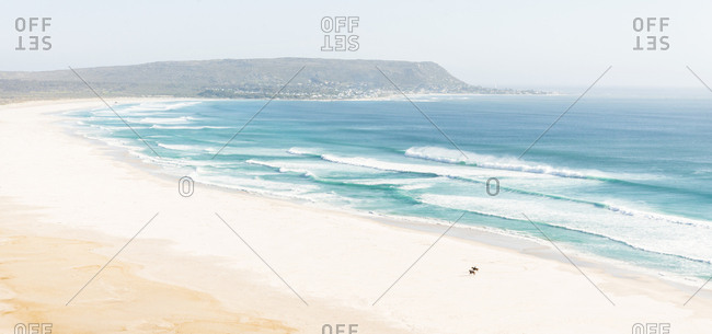 A landscape aerial picture of the beautiful Noordhoek Beach in Cape Town, South Africa.