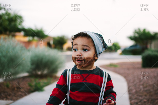 Toddler boy dressed for Halloween with beard and suspenders