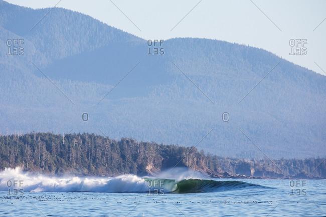 Curling waves in ocean near mountains