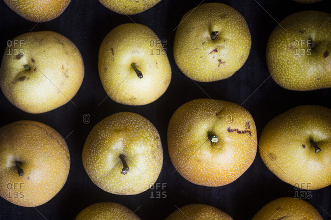 Asian pears on black background