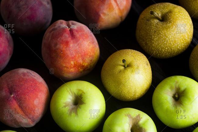 Colorful fresh fruit on black background