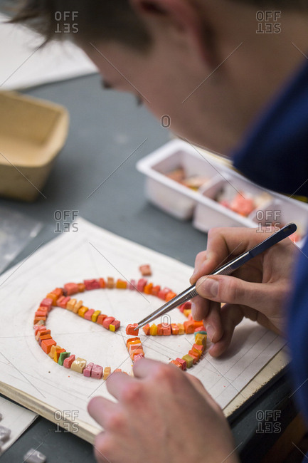 Spilimbergo, Italy - January 16, 2017: Pordenone, Italy - January 16, 2017: Young boy learns the art of mosaic in the oldest Mosaic School of Friuli