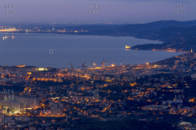 Trieste, Italy - November 9, 2016: View from above of Trieste and Miramare castle at twilight, Italy