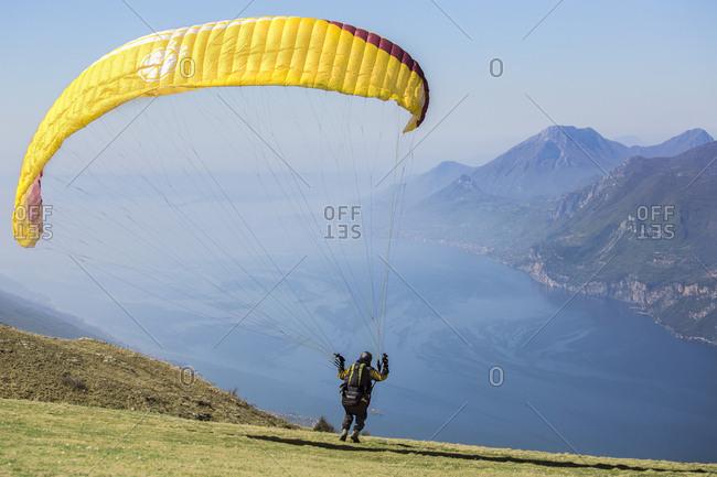 Lake Garda, Italy - April 8, 2017: Verona, Italy - April 8, 2017: Paragliding runs from Mount Baldo above  Garda lake