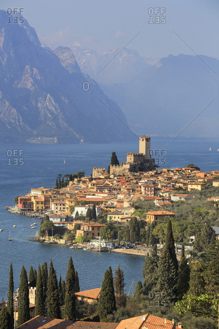 Lake Garda, Italy - April 8, 2017: Verona, Italy - April 8, 2017: View from the top of the small medieval village of Malcesine with  the Scaligero castle overlooking Garda