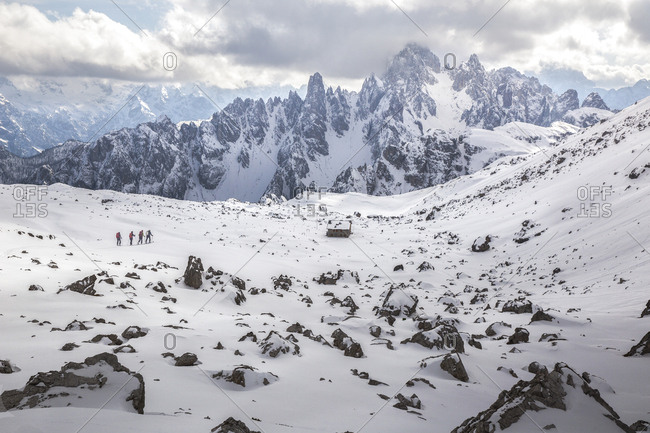 Hikers along the path leading to the Auronzo refuge in Tre Cime Natural Park, dolomites, Italy