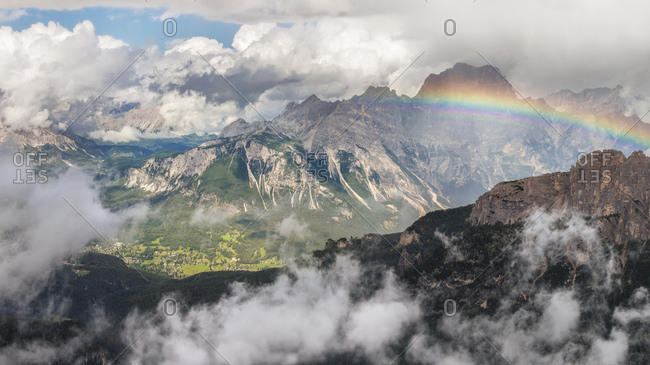 Rainbow above Cortina d'Ampezzo after an intensive thunderstorm, with the Sorapiss on the background photographed from the Nuvolau refuge, Dolomites, Cortina D'Ampezzo, Italy